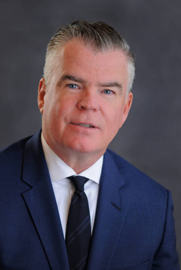 Head shot of John G. Caulfield Executive Vice President, Chief Operating Officer, Agency Lending
